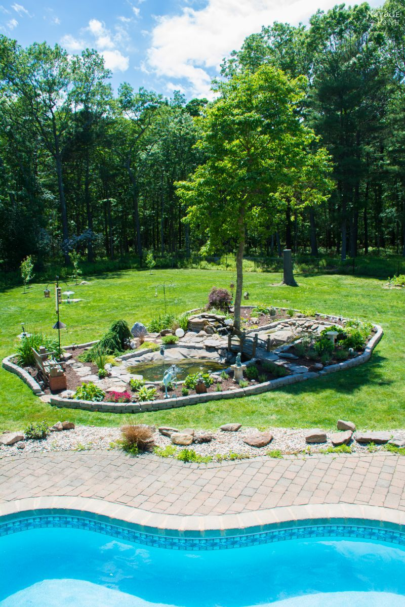 The Pond Project - Part 3: The Reveal | DIY pond and backyard makeover | DIY garden edging | How to lay edge stones | How to edge garden beds | Tips on landscaping | DIY garden decor | DIY koi pond lining | How to maintain a koi pond | Spring planting and transplanting | Pond and backyard reveal | Before & After | TheNavagePatch.com