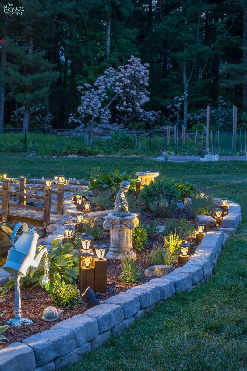 cedar cube solar landscape lights in a garden at dusk