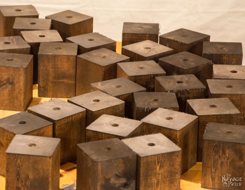 assortment of cedar cubes stained dark brown