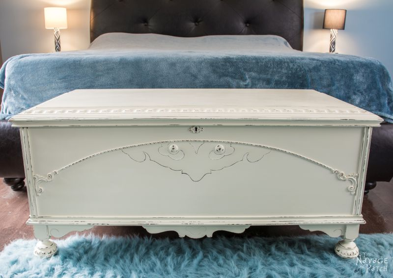 Cedar Chest Makeover | DIY furniture makeover with homemade chalk paint | How to cover wood stains when painting with chalk paint | Homemade chalk paint recipe | French country style painted furniture | Annie Sloan Old White color | Painted and distressed ornate furniture makeover | Transformed cedar chest | Before & After | TheNavagePatch.com