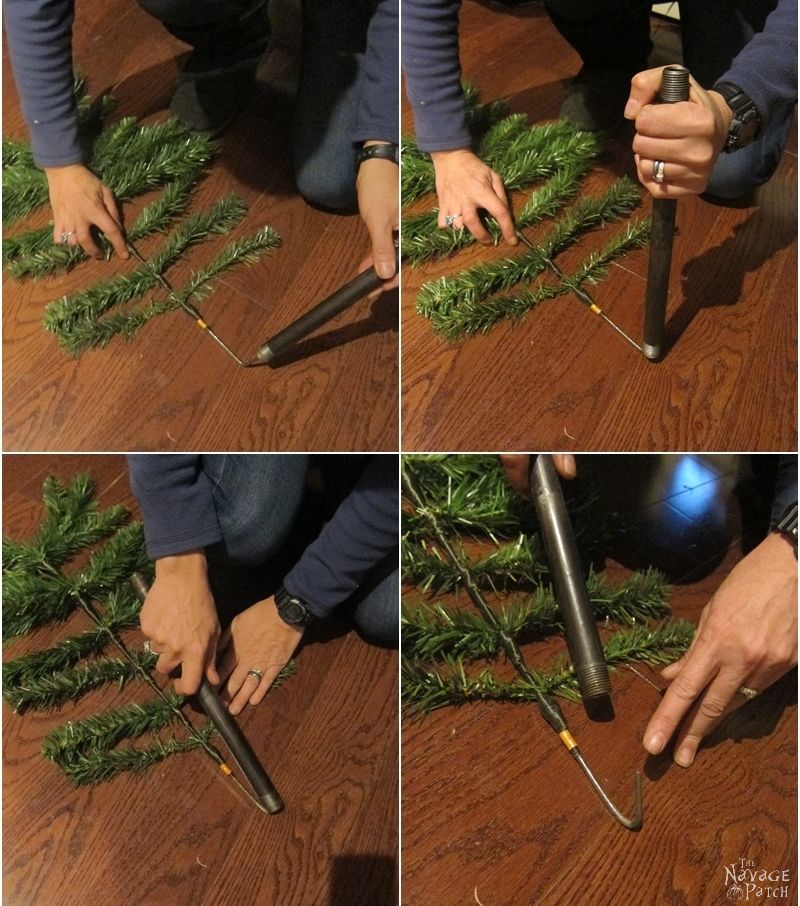 woman bending faux christmas tree branch stem with a pipe
