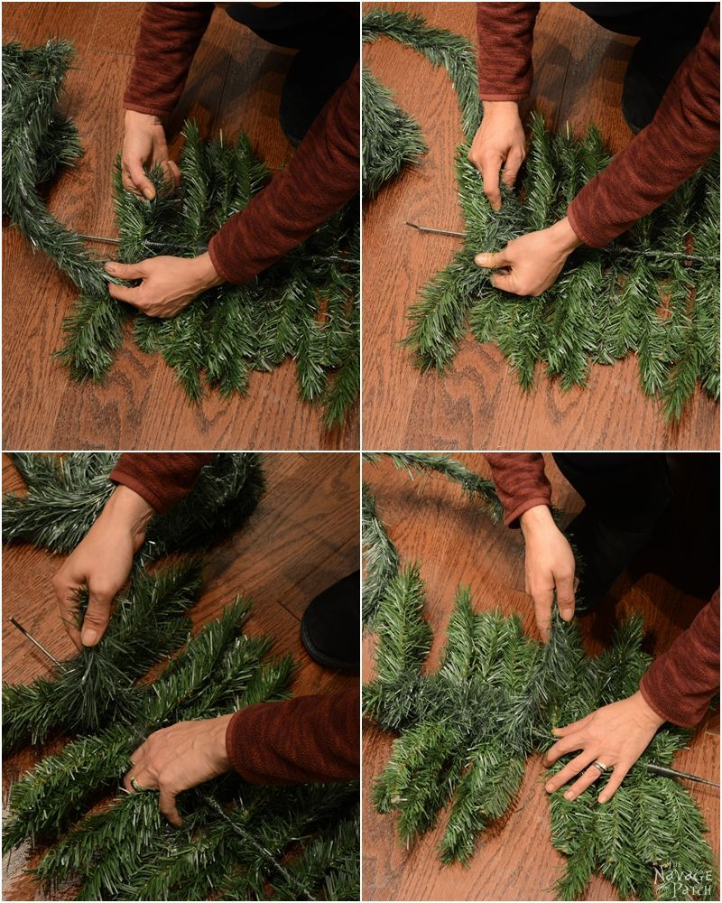 wrapping garland around some artificial christmas tree branches