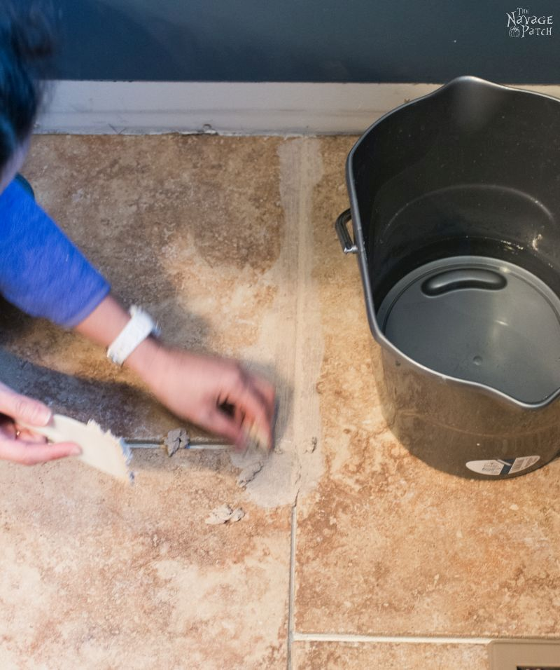 Guest Bathroom Renovation | How to tile a floor like a pro | DIY floor tiling | How to cut tiles | How to repair broken ceramic tiles | How to lay subfloor | DIY subflooring | How to grout tiles | DIY tile grouting and sealing | How to seal your tiles and grouting | DIY bathroom flooring | When to use concrete board as subfloor | How to choose grout color | DIY tile spacers | How to install ceramic tiles | DIY porcelain tiling | Before & After | TheNavagePatch.com