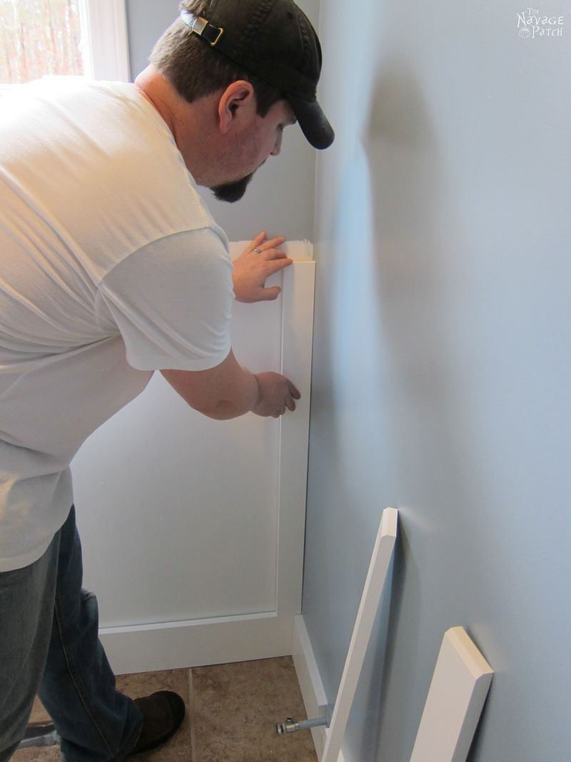 Guest Bathroom Renovation | How to install a toilet bowl | How to install wainscoting | How to install board and batten | DIY toilet bowl installation | DIY board and batten wainscoting | How to paint trim with no brush marks | How to paint windows | How to fix walls like a pro | DIY wall demolition | Best paint for bathrooms | Benjamin Moore Advance Paint | Before & After | TheNavagePatch.com