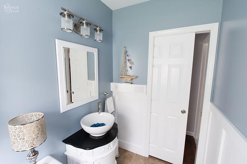 Guest Bathroom Renovation | DIY pocket door installation | How to install a pocket door | How to install drywall | How to install a door jamb | DIY board and batten wainscoting | Before and After | TheNavagePatch.com