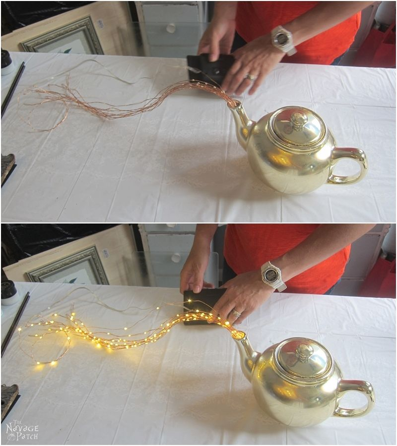 testing solar string lights before placing the teapot light in the garden