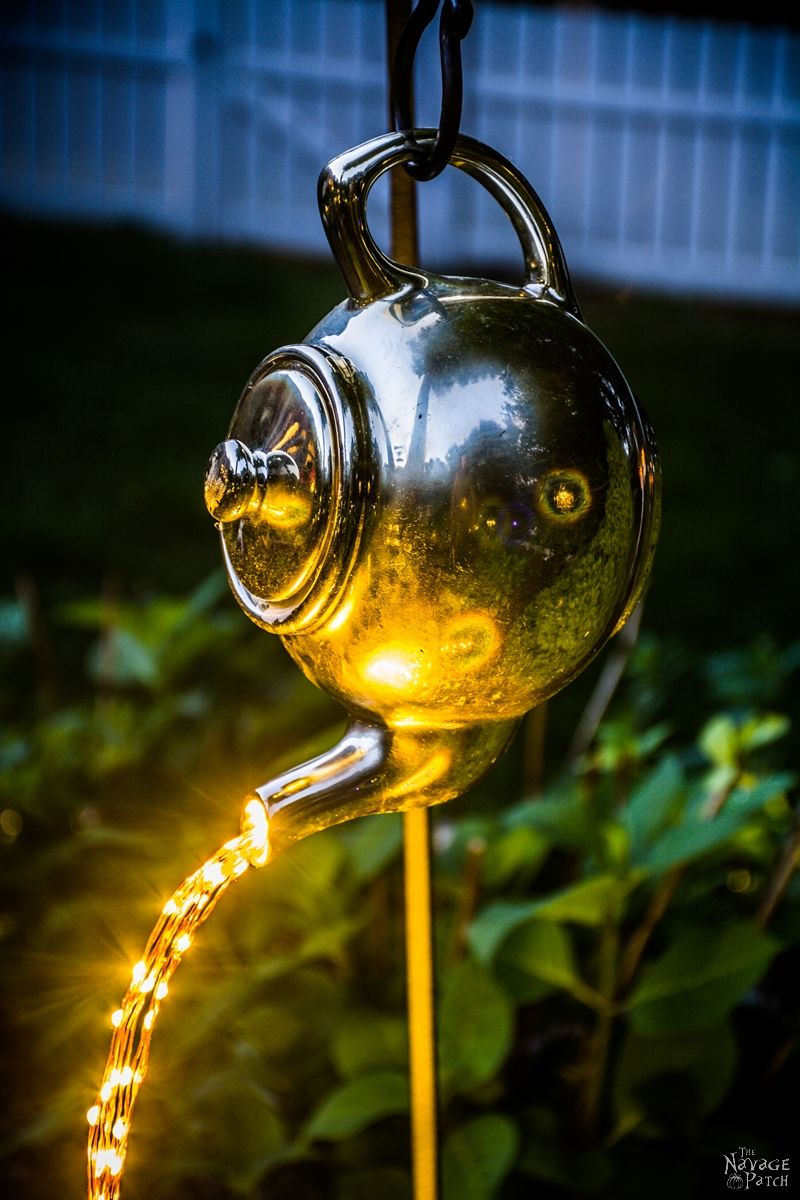 DIY Spilling Solar fairy Lights (Teapot Lights) in a garden at night