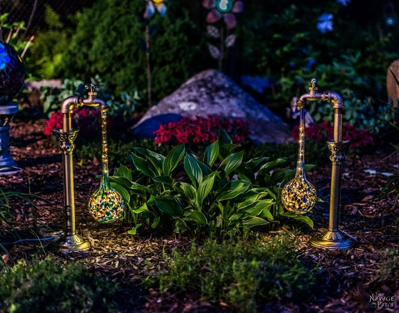 Side view of two DIY Solar Garden Lights in a garden at dusk