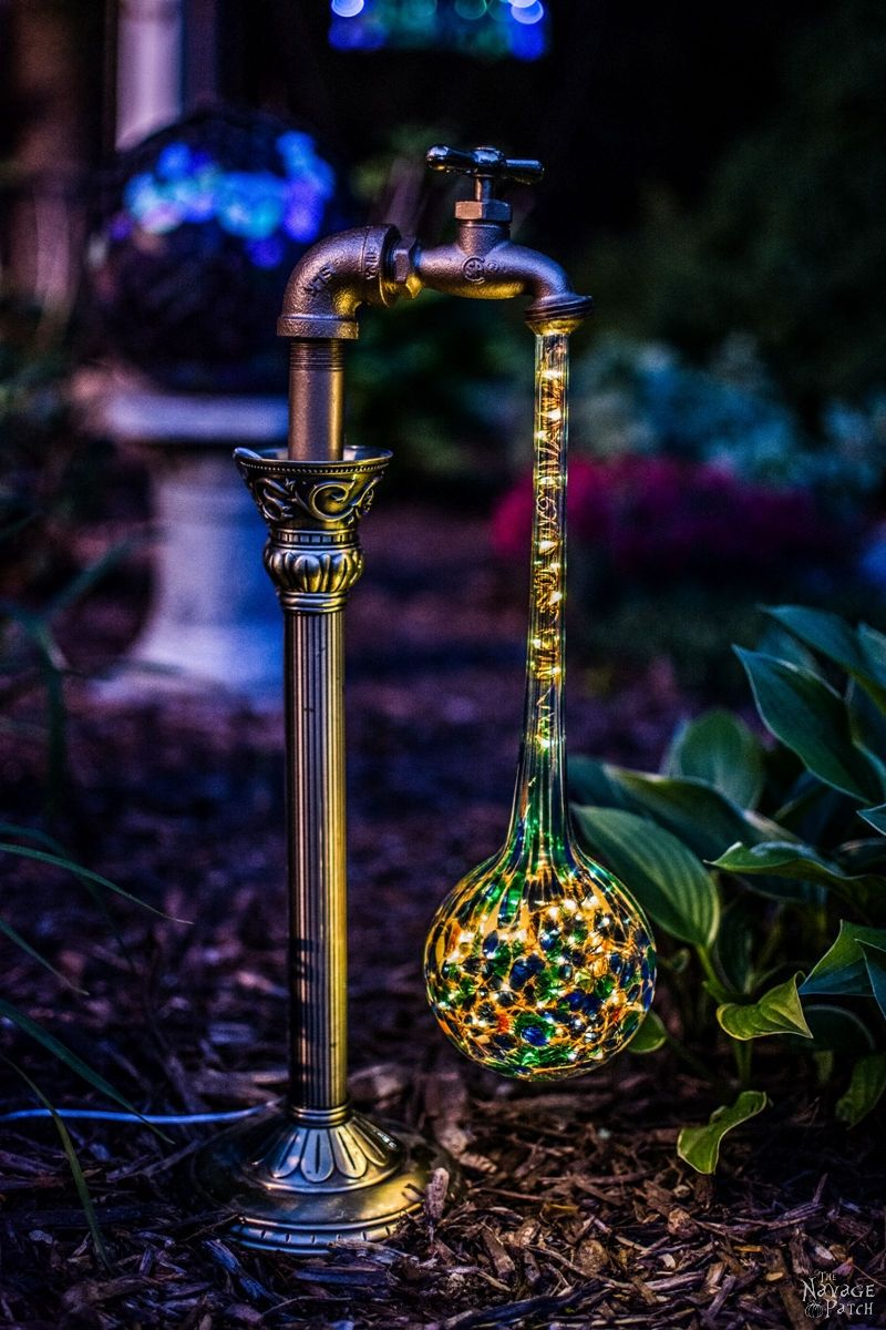side view of one solar garden light in a garden at dusk