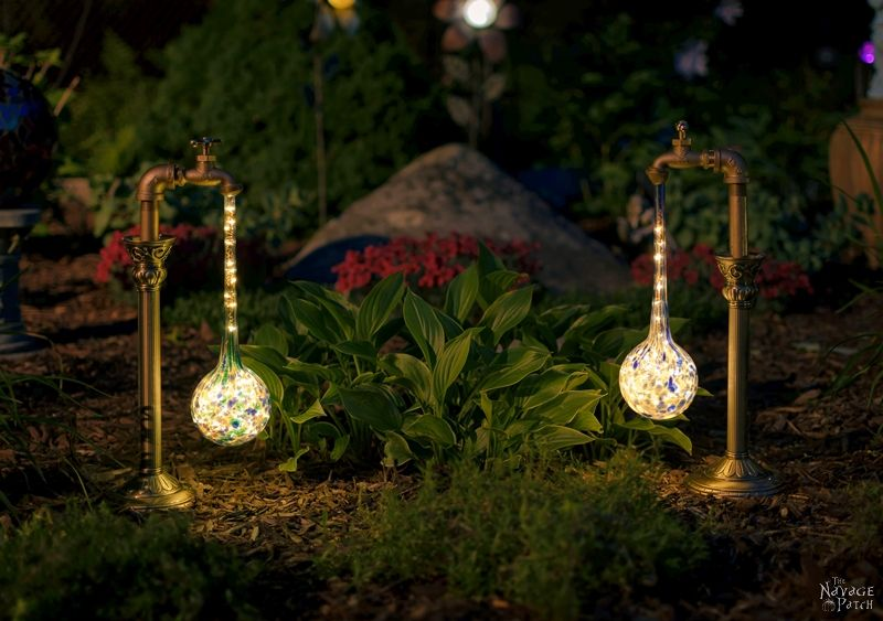 DIY Waterdrop Solar Lights | Easy, budget friendly and one of a kind DIY backyard ornaments and landscape lights | Upcycled candle sticks | Upcycled plant watering globes | Step-by-step tutorial for DIY waterdrop solar lights | DIY whimsical garden lights | Before & After | TheNavagePatch.com