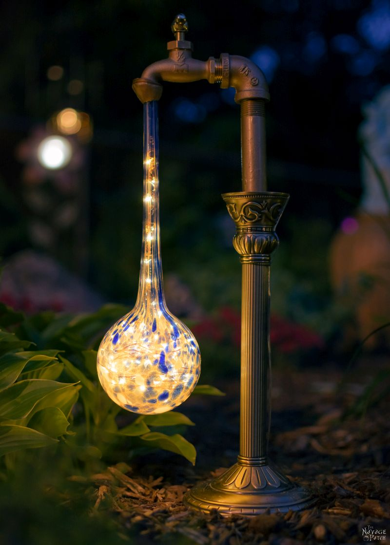 DIY Waterdrop Solar Lights | Step-by-step tutorial for DIY waterdrop solar lights | Upcycled candle sticks | Upcycled plant watering globes | DIY whimsical garden lights | #TheNavagePatch #DIY #Upcycled #SolarLights | Easy, budget friendly DIY backyard ornaments and landscape lights | TheNavagePatch.com