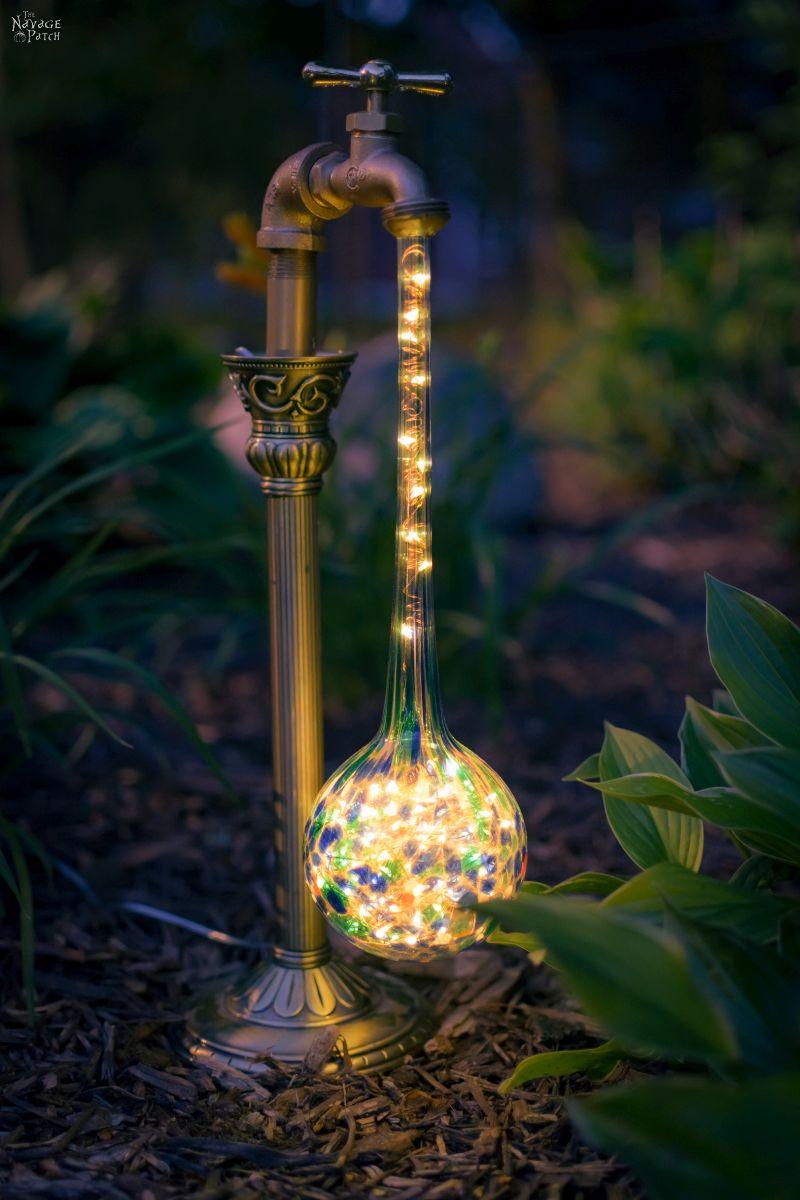 waterdrop solar light in a garden at night