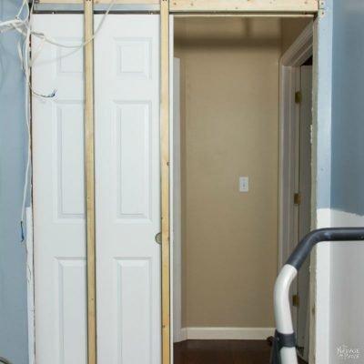 Guest Bathroom Renovation   DIY pocket door installation   How to install a pocket door   How to cut a door opening in a wall   How to make a door opening  How to paint a door   Before and After   TheNavagePatch.com