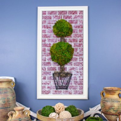 Topiary Wall Art | Joss & Main wall decor knock-off | DIY moss topiary wall decor | Upcycled metal basket | How to stencil | Homemade chalk paint recipe | How to fix a broken picture frame and make it look new | Creating a brick look with diy chalk paint | DIY 3D moss topiary wall art | Cheap & easy crafts | Simple DIY home decor | Evergreen wall decor | TheNavagePatch.com