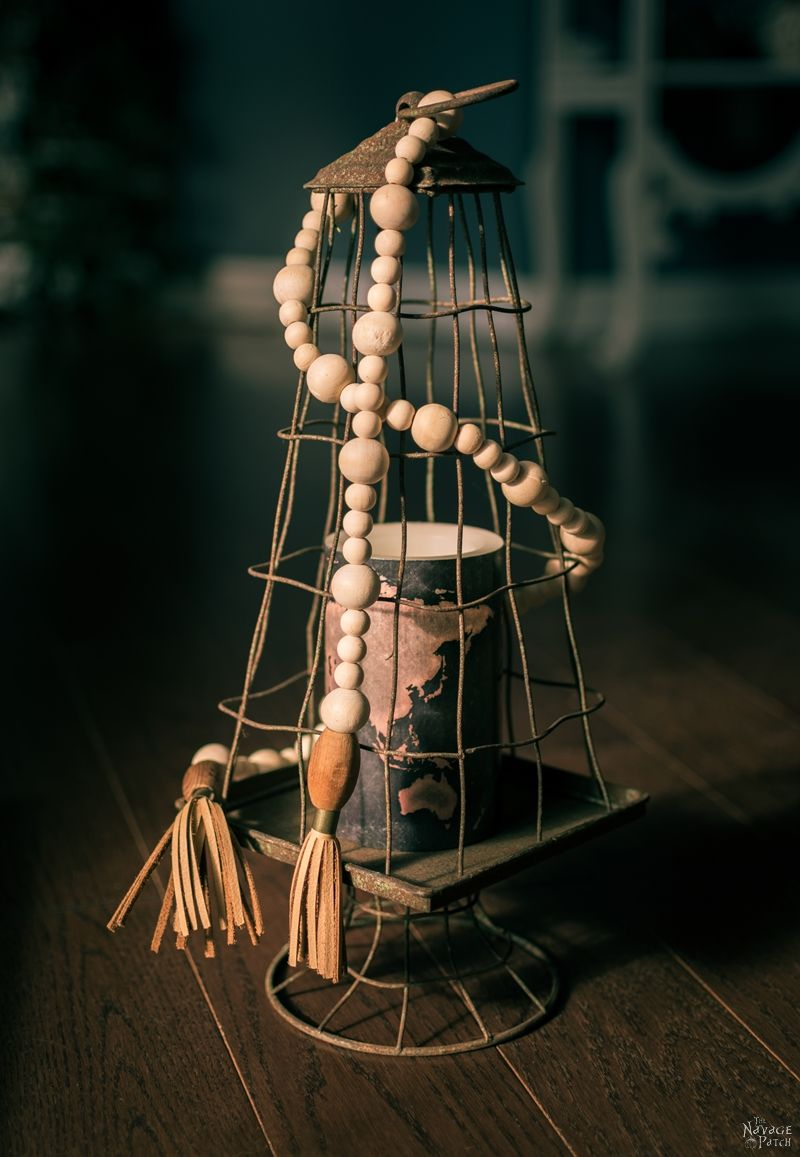 DIY Wood Bead Garland   How to make a wood bead garland in 5 minutes   DIY Bohemian style bead garland   DIY Bead Garland with DIY Tassels   Budget friendly farmhouse decor   DIY Bohemian style leather tassels   #DIY #tutorial #diytutorial #DIYHomeDecor #BohemianStyle #FarmhouseStyle   TheNavagePatch.com