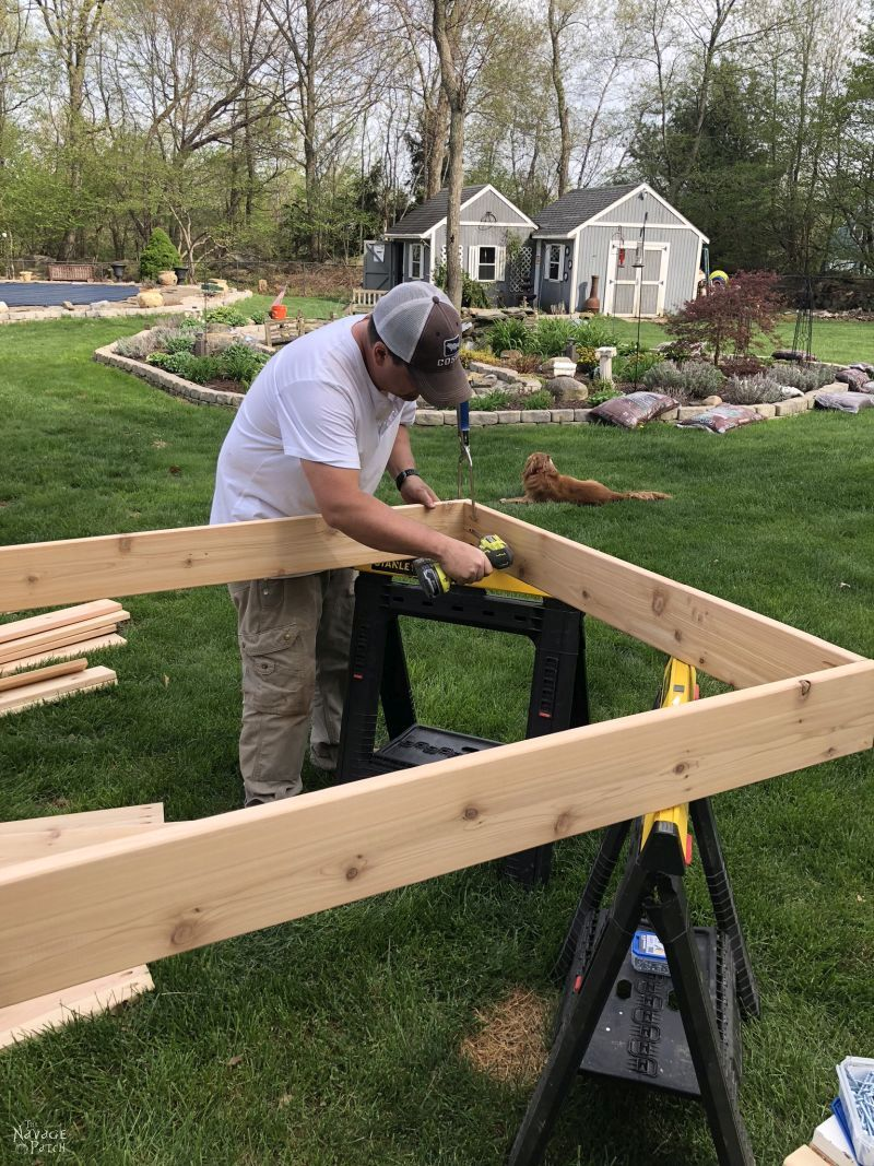 building the frame of a raised garden bed