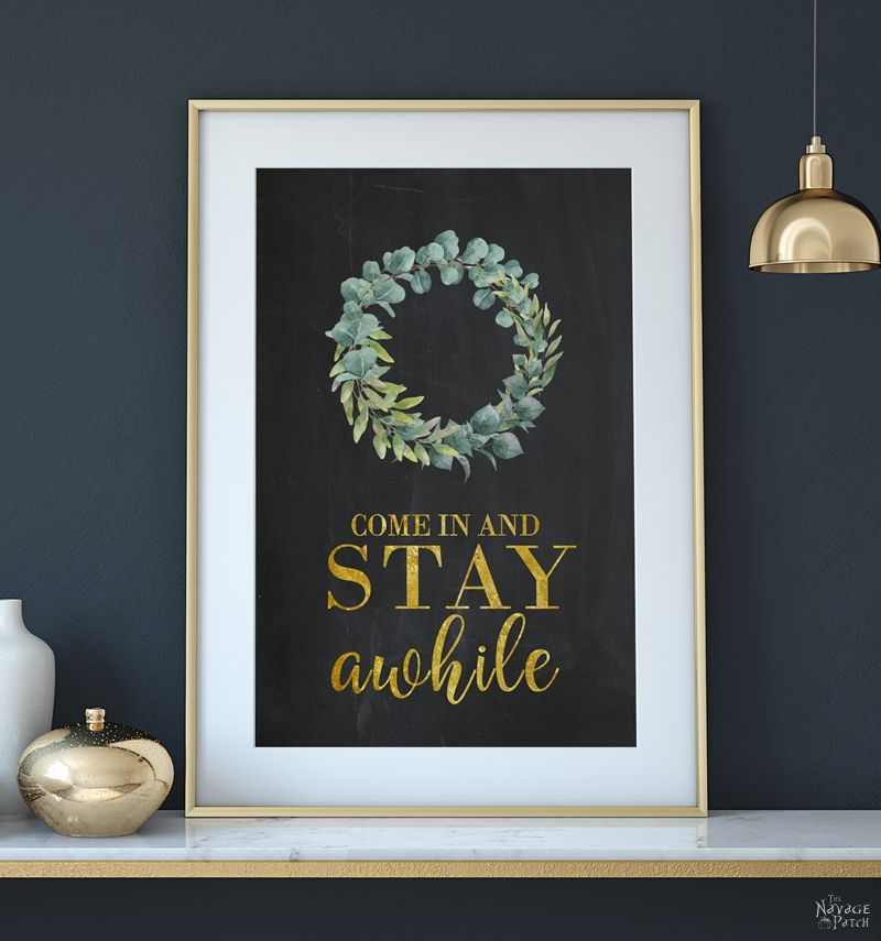 DIY Stay Awhile Sign with Free Printable | Free printable Stay Awhile sign and olive wreath | Free printable eucalyptus wreath and farmhouse style wall art | Gilded Stay Awhile sign | Ready to print DIY wall decoration | Upcycled frame | Stay Awhile sign with boxwood wreath | #TheNavagePatch #FreePrintable #GalleryWall #Upcycled #DIY #HomeDecor | TheNavagePatch.com