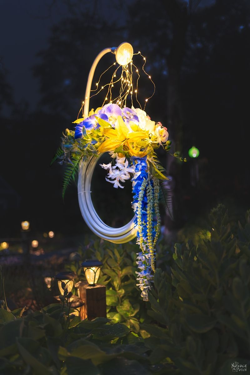 Lighted Garden Hose Wreath   DIY lighted summer wreath   Garden hose watering lights   Repurposed garden shed decor   Upcycled backyard decor   Summer wreath with fairy lights   #TheNavagePatch #GardenShed #garden #DIY #gardendecor #Upcycled #Repurposed #summerwreath #gardenart #diycrafts #Porchdecor #backyard #easydiy #outdoors #summerlife   TheNavagePatch.com