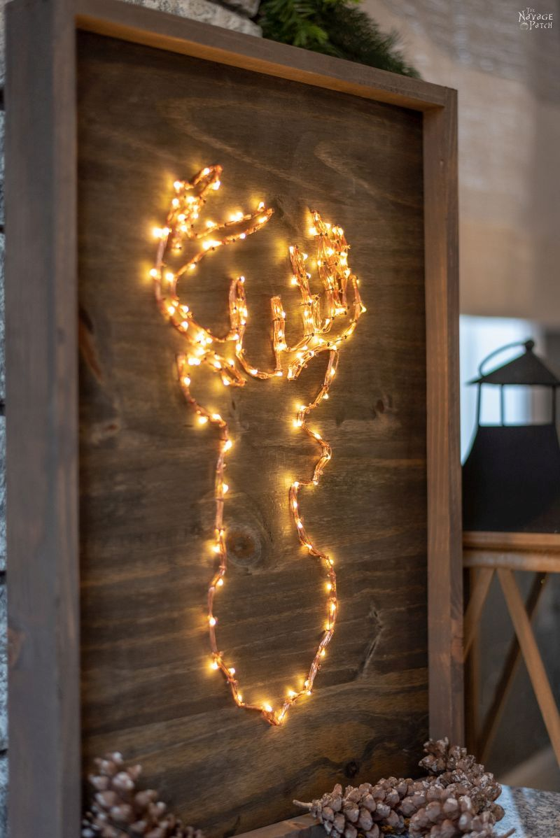 DIY Lighted Christmas Signs | DIY lighted reindeer decoration | DIY Christmas tree sign | Quick and easy DIY Christmas decoration with lights | Free printable reindeer template | #TheNavagePatch #DIY #freeprintable #Christmas #Holidaydecor #DIYChristmas #Christmascrafts #easydiy #Christmaslights #DIYHomedecor #Holidays #starrylights | TheNavagePatch.com