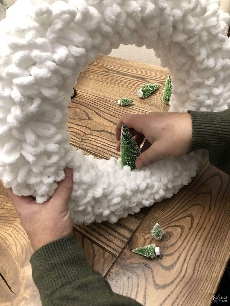 nestling bristle brush tree into loop yarn wreath
