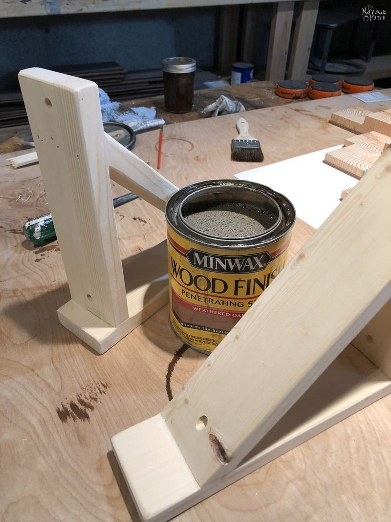 two diy corbel sconces and a can of stain