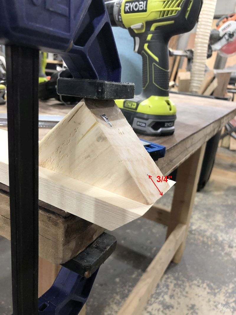 angled piece of wood clamped to another piece