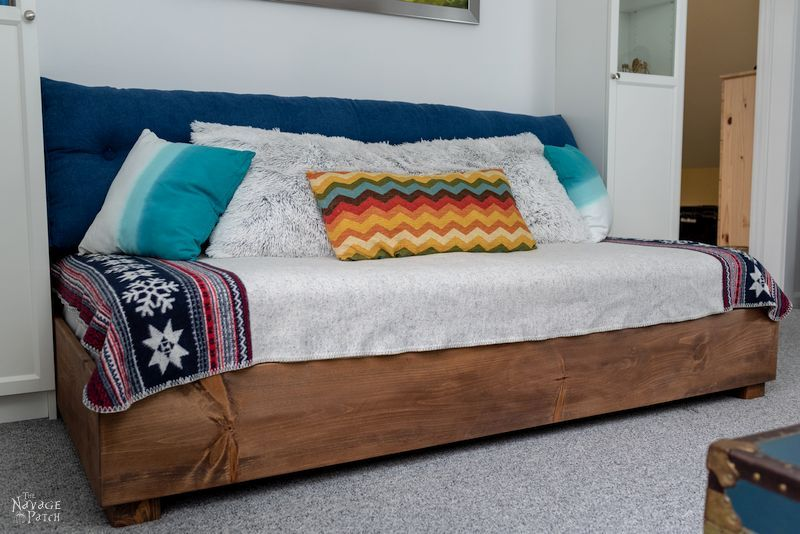 diy daybed between two tall bookcases