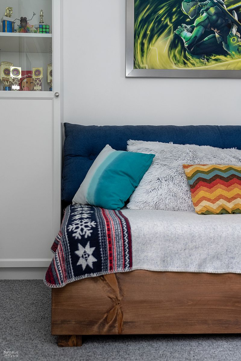 closeup of daybed next to a bookcase