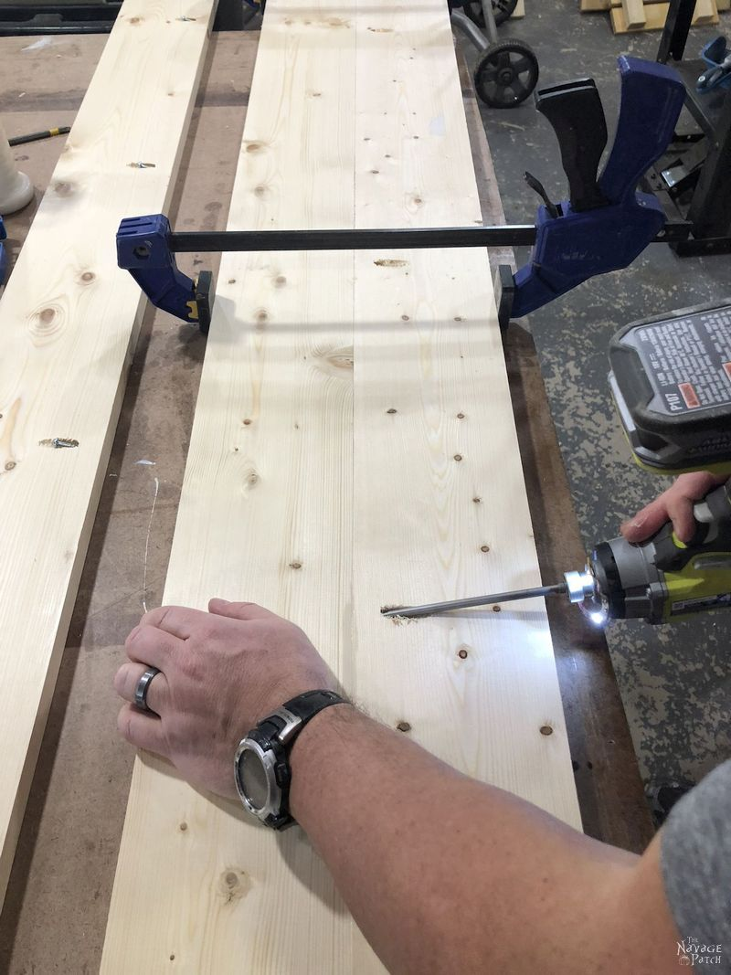 man attaching two boards together with pocket screws