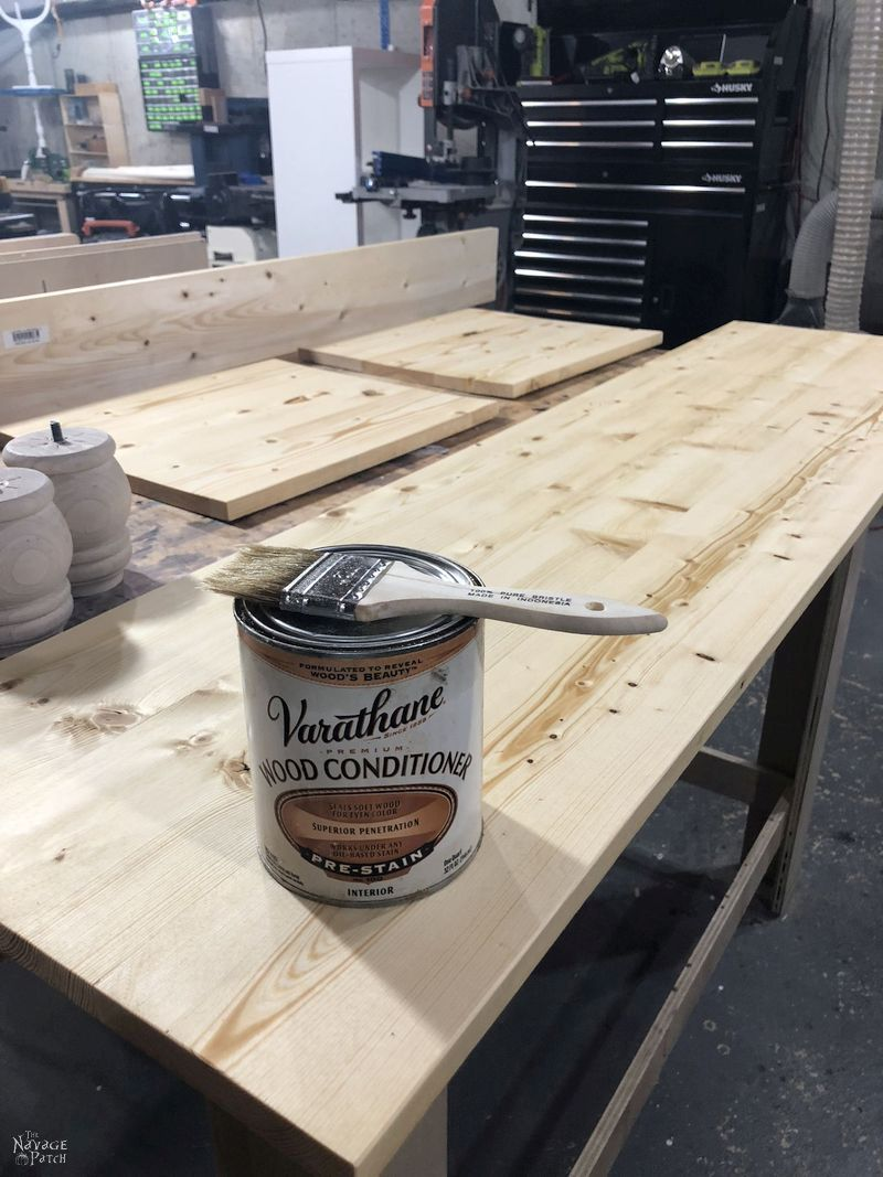 can of varathane pre-stain sitting on pine boards