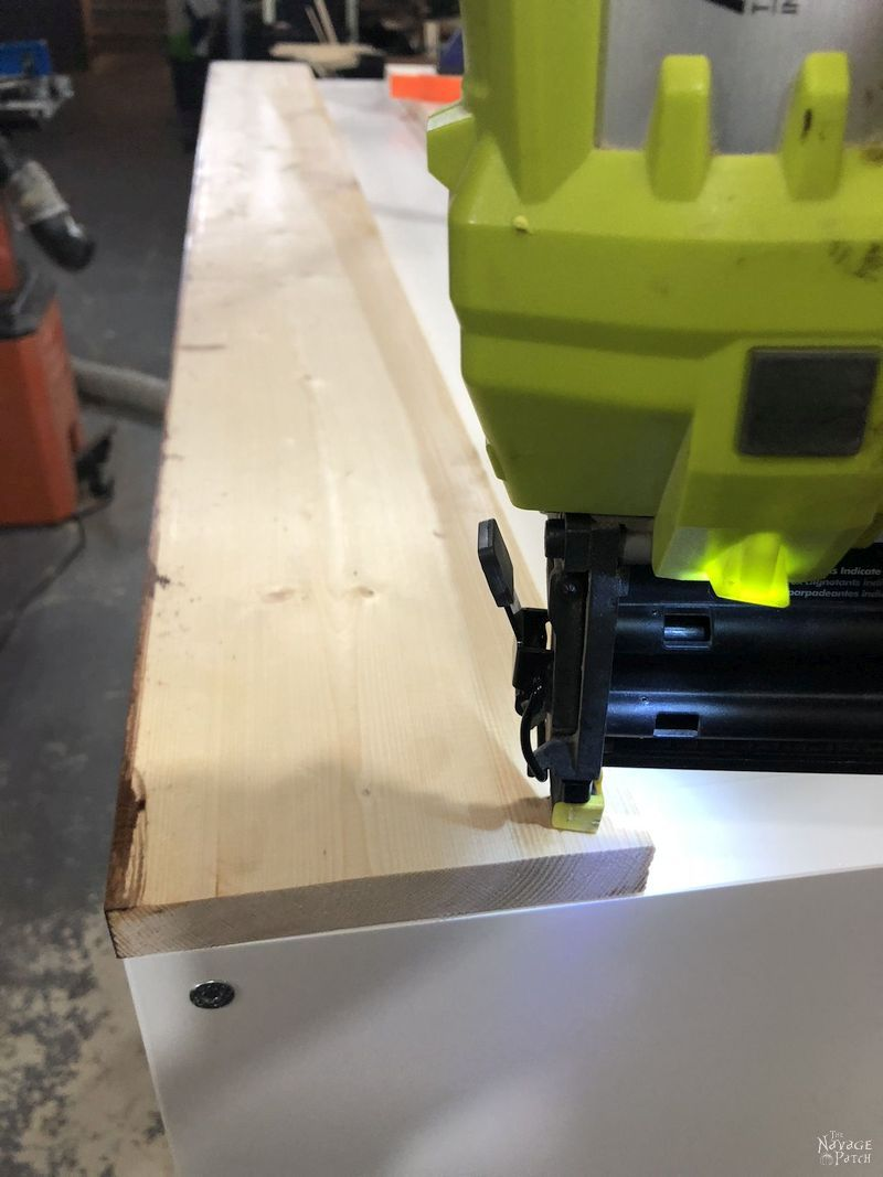 brad nailer driving a nail into a board