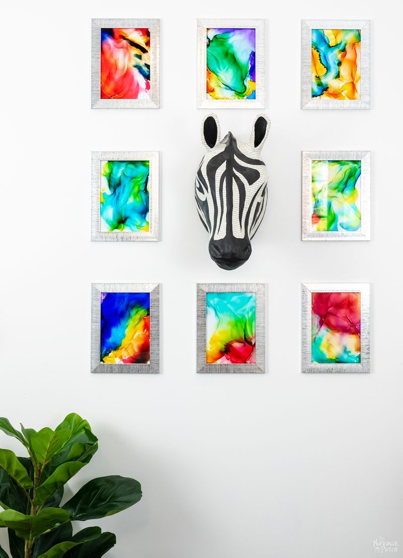 8 DIY Fired Alcohol Ink Art hanging on a white wall