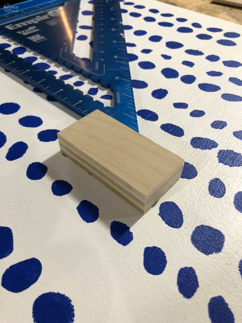 piece of wood sitting on painted plywood
