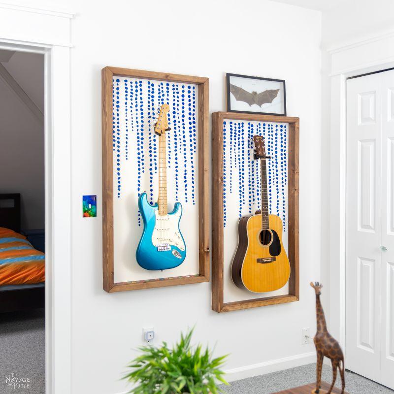 two guitars hanging in diy guitar display frames