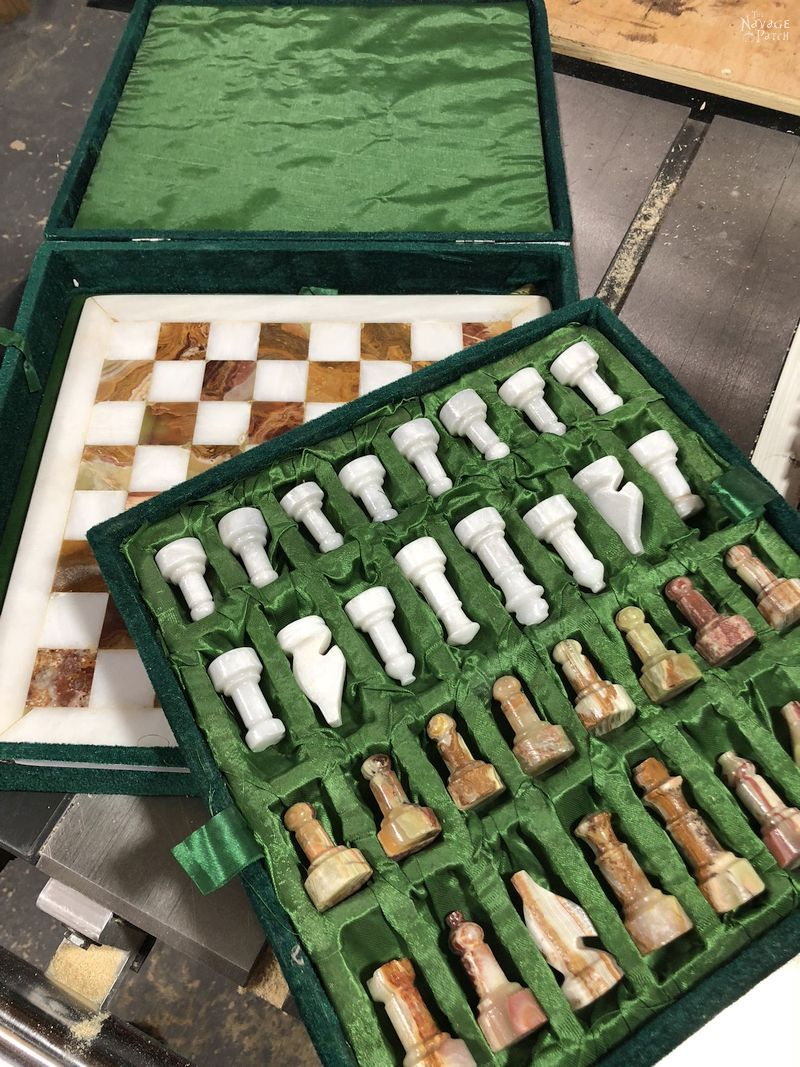 stone chess pieces and board
