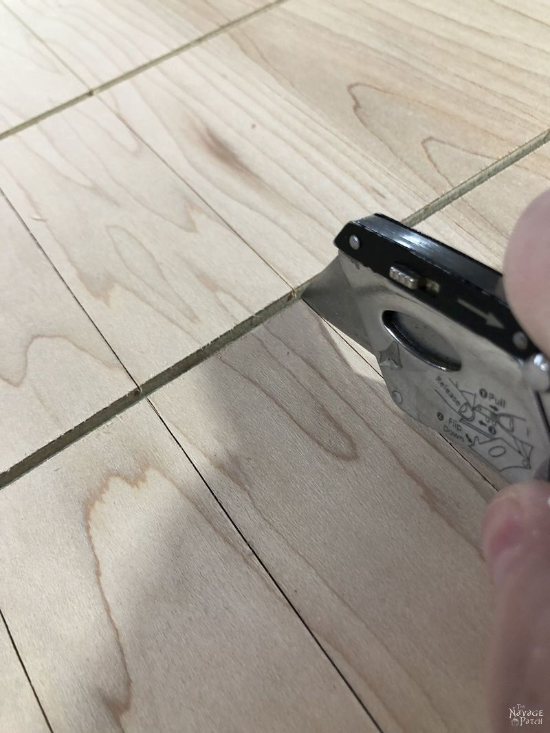 cutting a groove in plywood with a utility knife