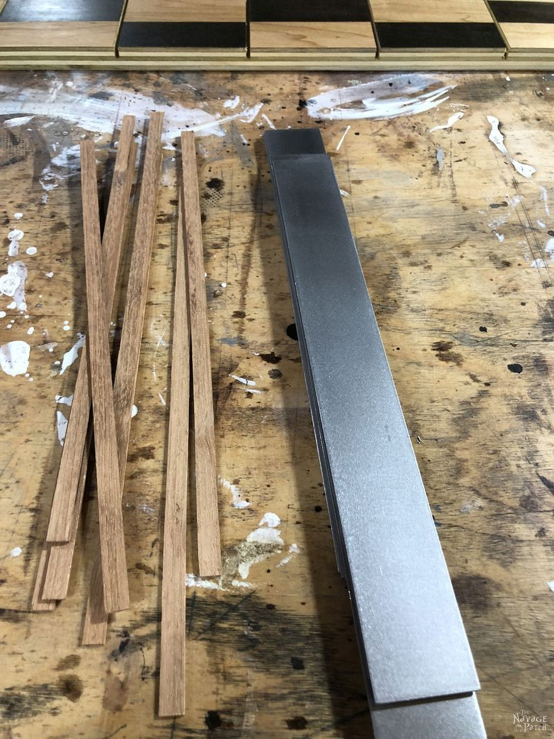 metal pieces and wood shims