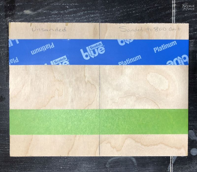 piece of plywood with green and blue tape on it