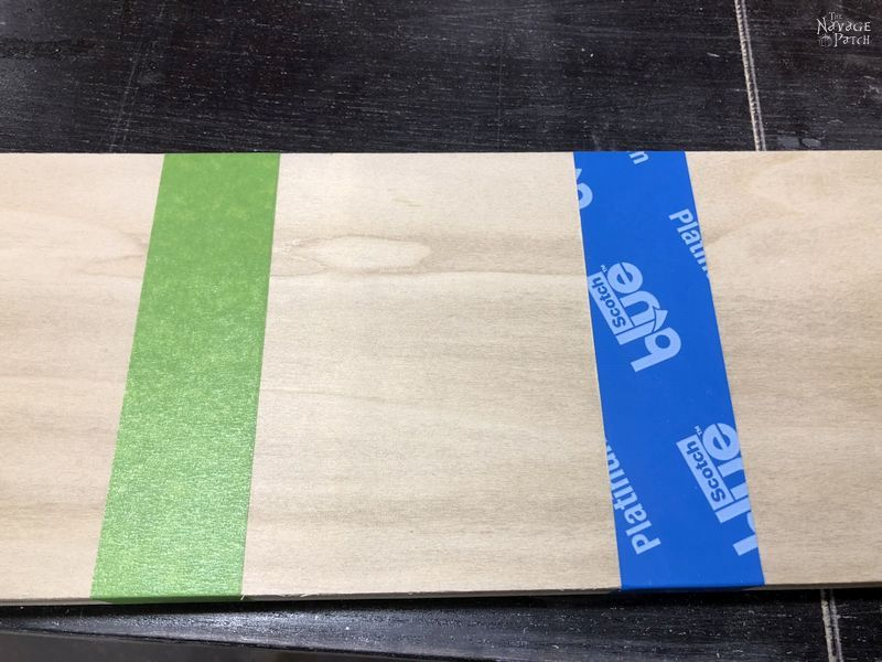 plywood with green and blue painter's tape