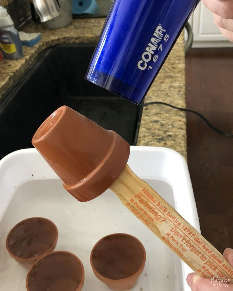 drying a terra cotta pot with a hair dryer