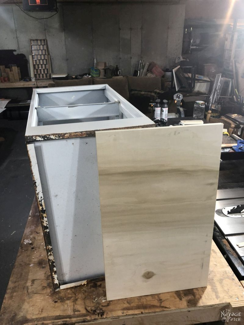 piece of plywood net to a metal filing cabinet
