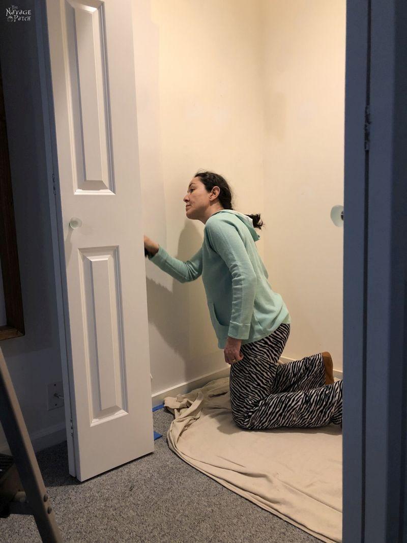 woman painting the closet walls