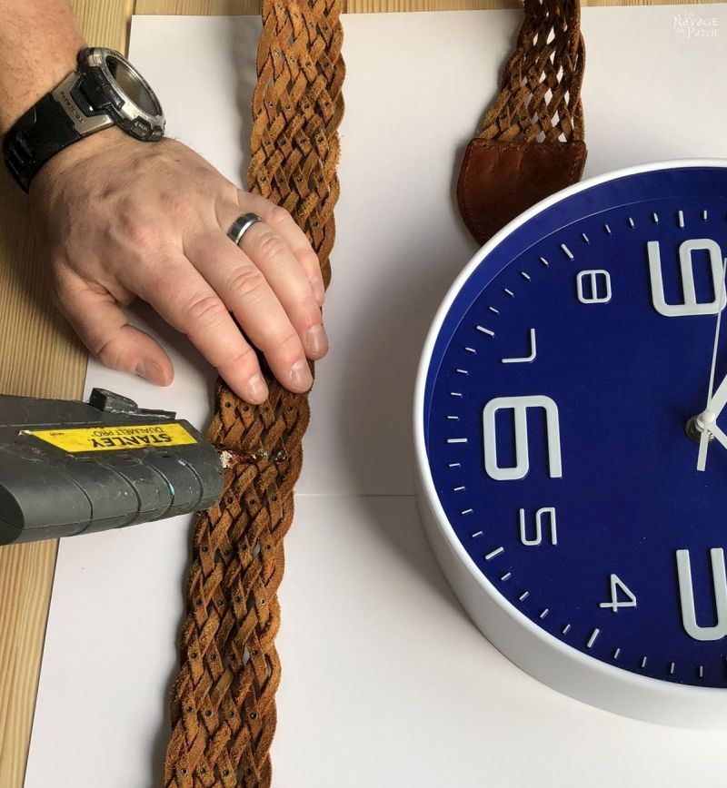 applying hot glue to a leather belt