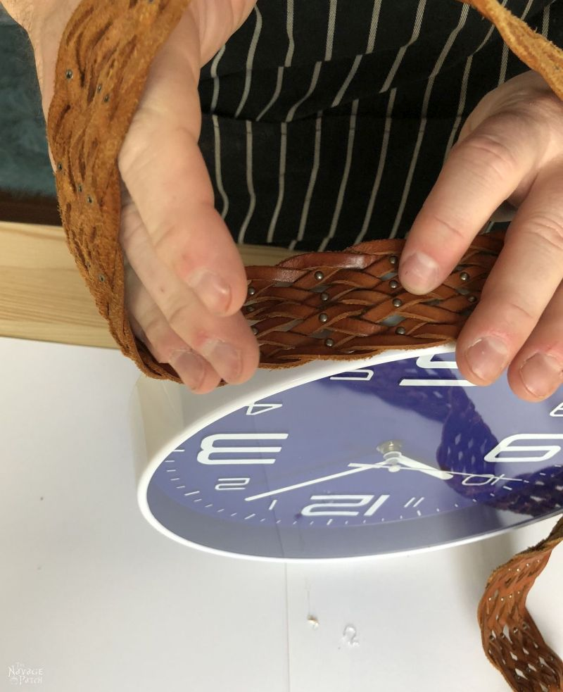 gluing a leather belt to a clock