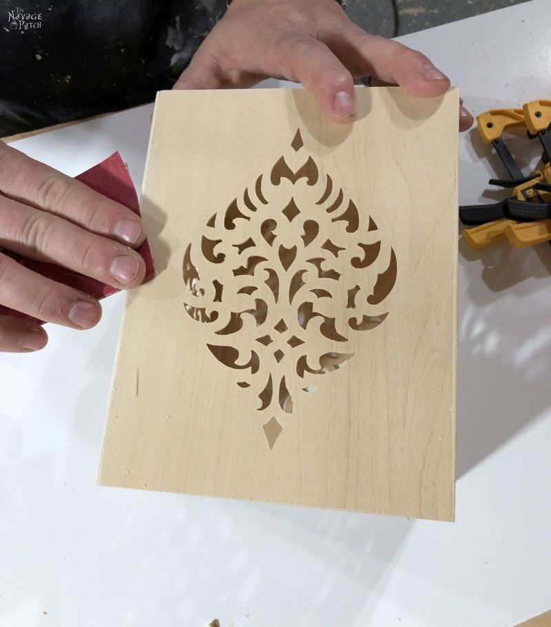 sanding a wooden diy moroccan candle holder