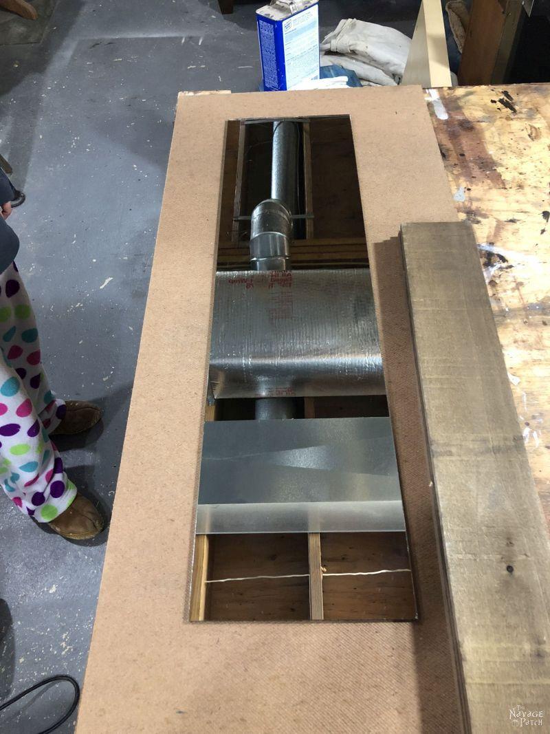 rectangular mirror on a work bench