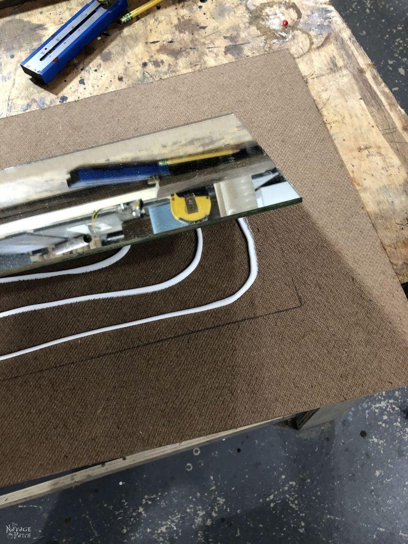 mounting a mirror on hardboard