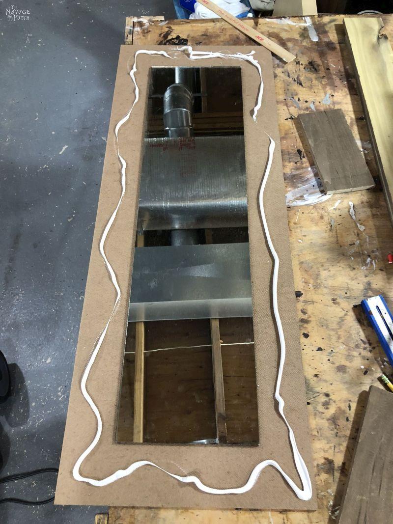 making a diy rustic mirror frame