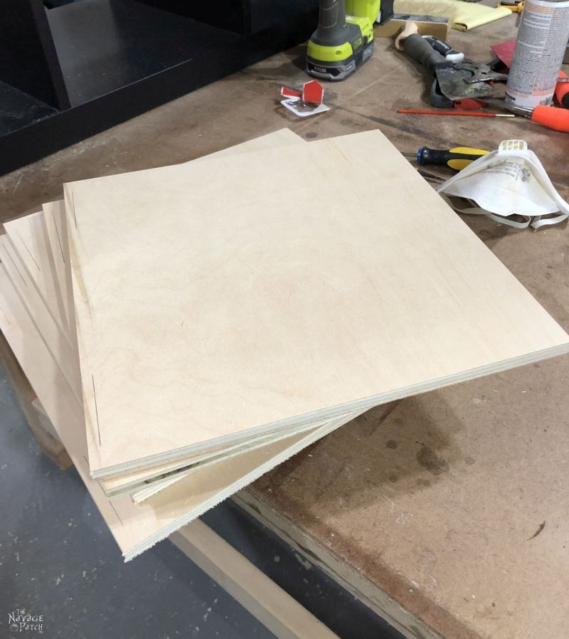 8 square plywood boards on a table