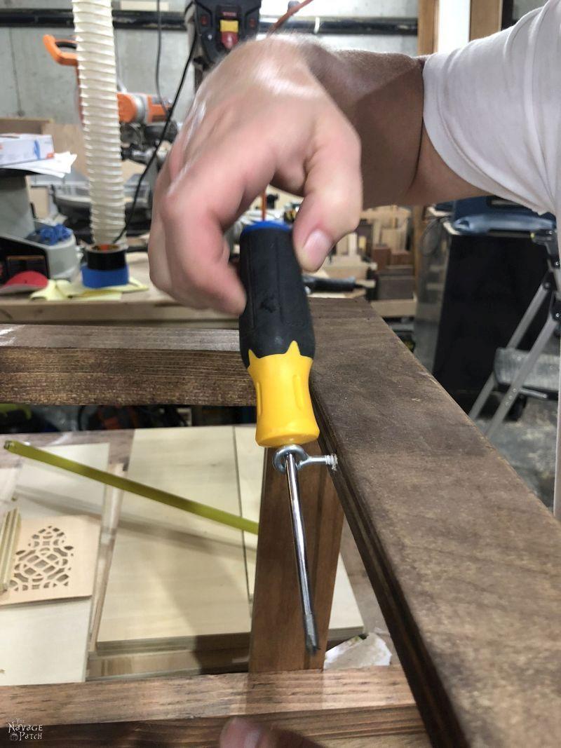 screwing an eye bolt into wood